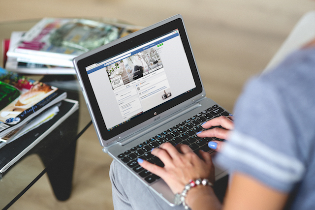 Facebook-myths-woman-typing-on-laptop.jpg