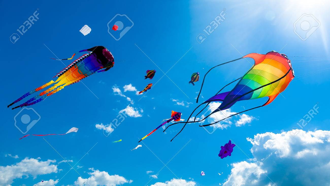 -kites-flying-on-the-blue-sky-in-the-kite-festival.jpg
